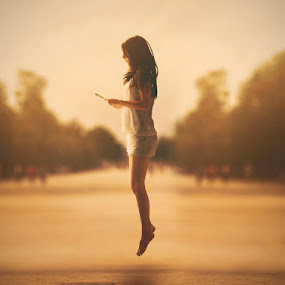 The girl who swam with books by Diana Grigore - People Fine Art ( girl, jumping, sunset, book, emotive, surreal, expressive, hair, people, bokeh, portrait, jump )