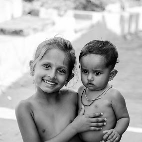 A caring one.... by Rahat Amin - Babies & Children Child Portraits ( black and white, care, children, baby, siblings )