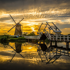 by Kevin Warrilow - Buildings & Architecture Public & Historical ( water, canals, sunset, kinderdijk, holland, reflections, bridges, windmills )