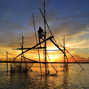 FISHING AT SUNSET by Dipankar Singha - Landscapes Sunsets & Sunrises