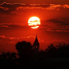 Sunset over church by John Ireland - Landscapes Sunsets & Sunrises