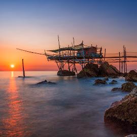 Trabocco Traforetto by Luca Nicoletti - Landscapes Waterscapes ( waterscape, abruzzo, sea, long exposure, stilt house, beach, sunrise, waterscapes, adriatic sea, italy, sun )