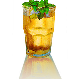 Mint Ice Tea Frosted Glass Reflection White Background by Robin Amaral - Food & Drink Alcohol & Drinks ( chilled glass, reflection, mint ice tea, ice tea, refreshment, mint, summer beverage, white background, leaves, tea, fresh herb, drink, organic mint, cool beverage, chilled tea )