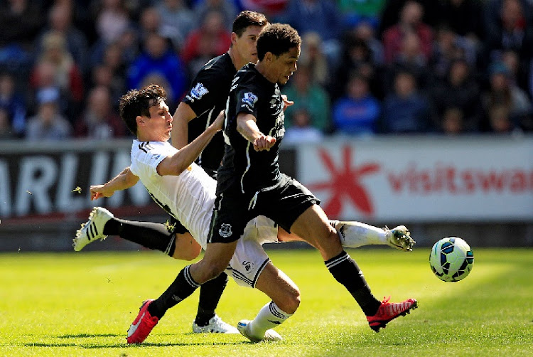 Jack Cork of Swansea City in action with Steven Pienaar of Everton