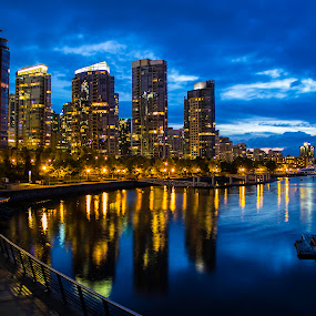 Vancouver waterfront by Doug Clement - Buildings & Architecture Office Buildings & Hotels ( pwcarcreflections, canada, vancouver bc, buildings, night, waterfront, reflection, reflections, people, places, architecture, building, lights, , city at night, street at night, park at night, nightlife, night life, nighttime in the city )