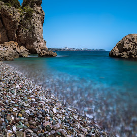 Pebbles and sea cliffs by Arif Sarıyıldız - Landscapes Beaches ( sea cliffs, sky, blue, sea, pebbles )