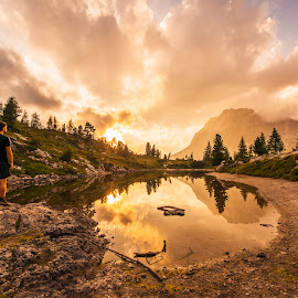 Male hiker at the lake by Aleš Krivec - Landscapes Waterscapes ( mountain, blue, limedes, lake, dolomites, landscape, italy, alps )