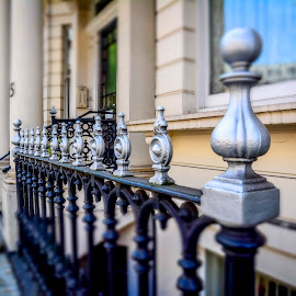 Fence Posts Along the Flats by T Sco - Buildings & Architecture Architectural Detail ( sidewalk, london, uk, street, detail, kensington, fence, people, scene, architecture )