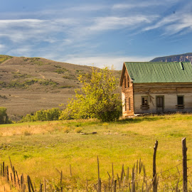 Abandoned Farmhouse by Mike Moody - Buildings & Architecture Decaying & Abandoned ( clouds, hills, fence, tin roof, farmhouse )