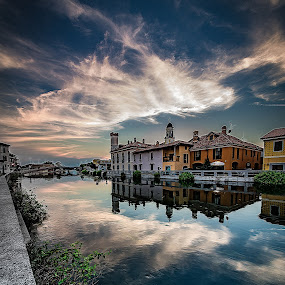 Gaggiano sul Naviglio by Alessio Coluccio - Landscapes Waterscapes ( clouds, waterscape, colors, sea, house, landscape, city, sky, sunset, cloud, naviglio, bridge, milano, rocks )