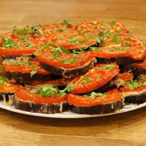 Eggplant Slices In The Oven With Cheese And Tomatoes.