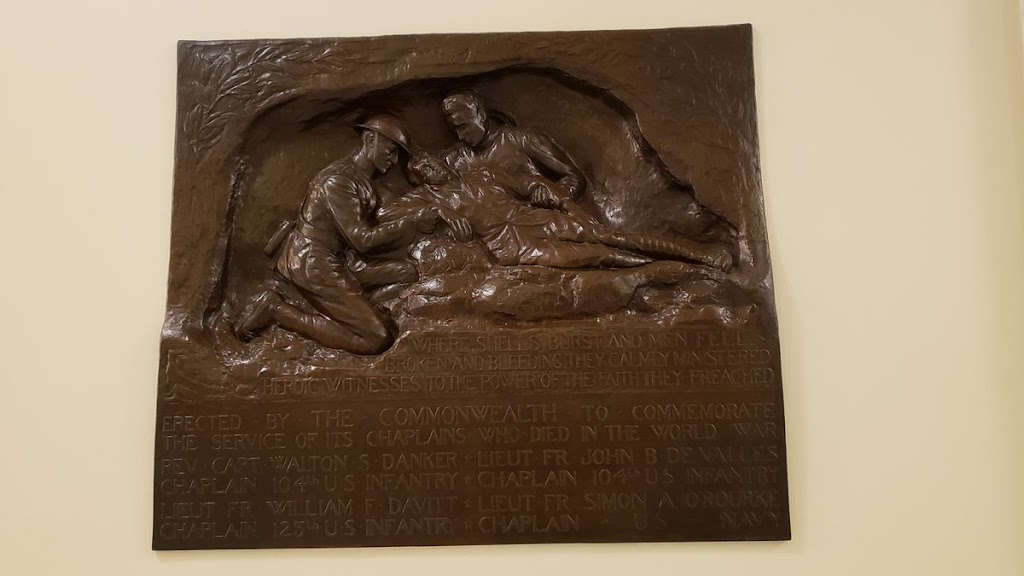 WHERE SHELLS BURST AND MEN FELL BROKEN AND BLEEDING THEY CALMLY ADMINISTERED HEROIC WITNESS TO THE POWER OF THE FAITH THEY PREACHED ERECTED BY THE COMMONWEALTH TO COMMEMORATE THE SERVICE OF ITS ...