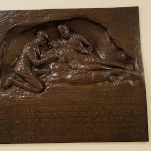 WHERE SHELLS BURST AND MEN FELLBROKEN AND BLEEDING THEY CALMLY ADMINISTEREDHEROIC WITNESS TO THE POWER OF THE FAITH THEY PREACHEDERECTED BY THE COMMONWEALTH TO COMMEMORATETHE SERVICE OF ITS ...