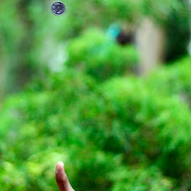 Head Or Tail..... by Abhiraj Krishna - Abstract Patterns ( hand, girl, green, coin, shutter, motionfreeze, fast )