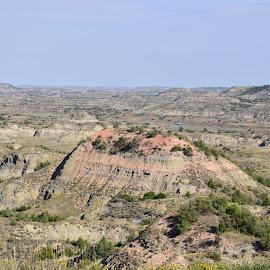 Badlands by Sandra Haroldson - Landscapes Caves & Formations ( god's country, open, colorful, rock formation, badlands )