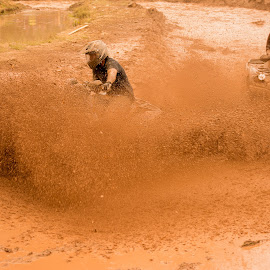 by Matt Pasqualetto - Transportation Other ( turn, speeding, orange, mud, racing, brown, atv, fast, black )
