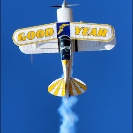 GOOD YEAR by Craig McNiven - Transportation Airplanes ( flight, sky, plane, goodyear, blue, year, good, bi, smoke, up,  )