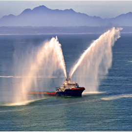 Testing Fire equipment by Mel Dicker - Transportation Boats