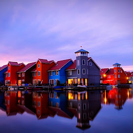 Sunset reitdiephaven by Paolo Testa - Landscapes Sunsets & Sunrises ( clouds, water, reflection, reitdiephaven, cityscape, architecture, seascape, landscape, sun, colours, sky, sunset, dutch, long exposure, evening )