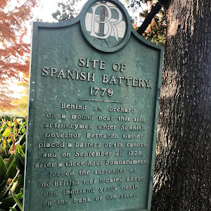 Behind an orchard on a mound near this site artillerymen under Spanish Governor Bernardo Galvez placed a battery of six cannon and on September 21, 1779, after a three-hour bombardment, forced the ...