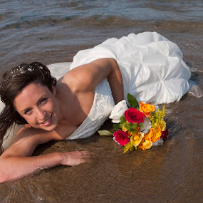 Beauty on the beach by Julie Wetherell - Wedding Bride ( bouquet, wedding, in the water, sea, wedding dress, bride, on the beach )
