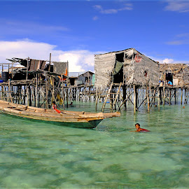 by Alvin Ngow - Landscapes Travel ( freedom, moods, innocent, fishing village, people, asian, borneo, sabah, sky, nature, village, family, semporna, travel locations, malaysia, tourism, kids, waterscapes, relaxing, fishing boat, holiday, sampan, sea gypsy, mood factory, children, carefree, landscape, water house, photography, island, child, clear, blue sky, life, transport, poverty, swim, asia, gypsies, bajau laut, water, houses, green, play, sea, seascape, boat, color, blue, outdoor, background, island hopping, landscapes,  )