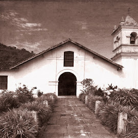 by Johannes Oehl - Buildings & Architecture Public & Historical ( tourist attraction, cartago, old, adventure tourism, little, bell tower, architecture, historic, sustainable tourism, monochromatic, ancient, general view, culture and the arts, adventure and extreme, ground level view, colonial, cultural tourism, central america, architecture-photography, forest, one object, vintage effect, monastery church, franciscans, tropical climate, bell, roman catholic church, sun light, catholic church, small, religious, natural light, sepia, monochrome, deep focus, christianity, america, black and white, tropical zone, ecotourism, landscape, responsible tourism, creative image, tropics, front view, crucifix, daytime, exterior view, attractive, costa rica, tropical garden, franciscan, morning time, orosi, beautiful, christian tourism, scenic )
