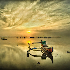 Sunrise/waterscape  by Bobo Tandiono - Transportation Boats ( reflection, boat.clouds.sunrise.waterscape )