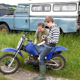 Bike by Caroline Beaumont - People Family ( dad, bike, motorcycle, son, boy, man )