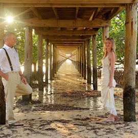 Sunset under the bridge by Andrew Morgan - Wedding Bride & Groom ( love, zanzibar, sunset, destinationwedding, beach, bridge, travel, paradise, island )