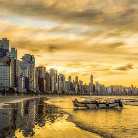 Sunset in Camboriu Beach by Rqserra Henrique - City,  Street & Park  Vistas ( built, beach, sunset, fishermen, clouds, boat, rqserra,  )