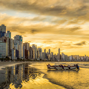 Sunset in Camboriu Beach by Rqserra Henrique - City,  Street & Park  Vistas ( built, beach, sunset, fishermen, clouds, boat, rqserra )