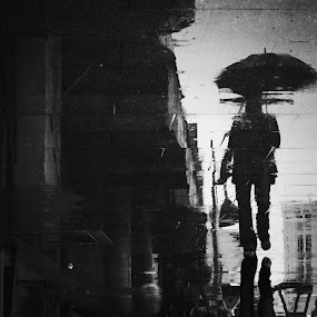 under the rain by Firdaus Hadzri - City,  Street & Park  Street Scenes ( reflection, black and white, penang, alone, street photography, firdaus hadzri )