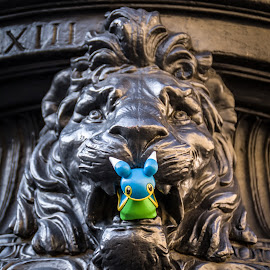 Old art eats new toy by Maurizio Riccio - Artistic Objects Toys ( lion, sculpture, florence, pokemon, artistic objects )