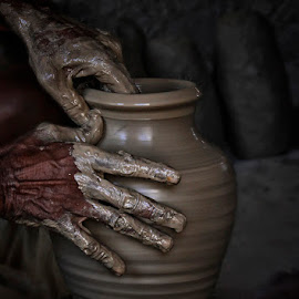 Wet Pot by Abdul Rehman - Artistic Objects Other Objects ( clay, colour, beautful, natural light, mud, wet hands, hands, colorful, colors, pottery, artistic object, artist, beauty, natural, pot )