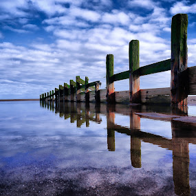 by Paul Stevenson - Landscapes Waterscapes ( sand, seashore, sky, wave-breakers, sea, pwcreflections-dq )