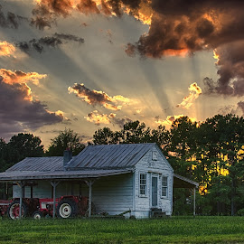 Barn Sunset by Nancy Arehart - Landscapes Sunsets & Sunrises ( clouds, barn, sunset, tractor, rays )