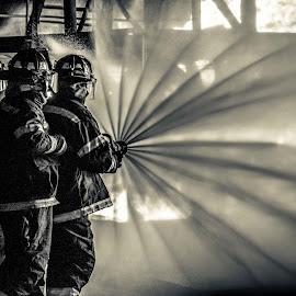 Fireman by Diana Sanderson - People Professional People ( water, training, fireman, firehose, fire )