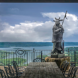 Top Of The Rock  by Esther Lane - Buildings & Architecture Statues & Monuments ( clouds, mo., statues, top of the rock, branson, indian, lake, native american )