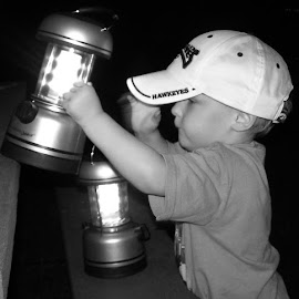 Keeper of the lights by Debra Griffin - Babies & Children Children Candids ( child, black and white, camping, priceless, lanterns )