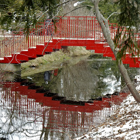 Beckoning Bridge by Kathy Woods Booth - Buildings & Architecture Bridges & Suspended Structures ( mirrored reflections, red, waterscape, reflections, bridge )
