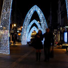 Beneath the Arches by DJ Cockburn - Public Holidays Christmas ( south molton street, arch, promenade, christmas lights, street, christmas, lights, winter, london, night, couple, oxford street, walk )