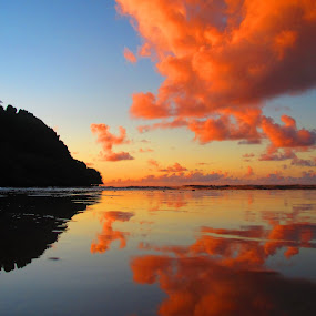 Island Sunset by Leimaile Guerrero - Landscapes Sunsets & Sunrises ( kauai, red clouds, island sunset, sunset, tropical, hawaiian sunset )