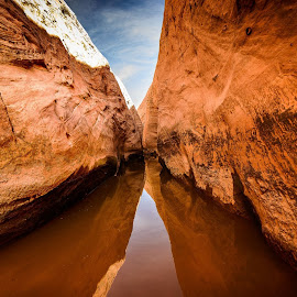 Slot Canyon with Water by Jerry Cahill - Landscapes Caves & Formations