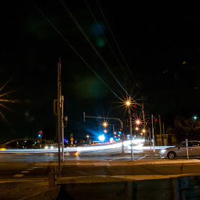 Intersection by Mark Luyt - City,  Street & Park  Night ( cars, car, street lights, intersection, night, busy, long exposure, car lights, lights, traffic )