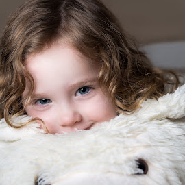 Bear Rug Hug by David Slack - Babies & Children Children Candids ( child, girl, hug, cuddly, toy bear, cute, curly hair, bear rug )