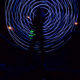 JuxtaPONDition by Savannah Eubanks - Abstract Light Painting ( pond, woman, blue, reflection, night, silhouette, light painting, circle, water )