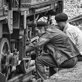 Maintenance Job by Marco Bertamé - Black & White Portraits & People ( steam engine, two, sitting, wheel, metal, cap, men, working, man, steam )