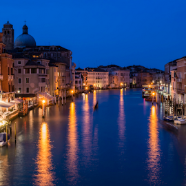 Venice in the night by Deyan Georgiev - City,  Street & Park  Night ( illuminated, famous, europe, italian, exterior, street, reflections, transportation, cityscape, architecture, travel, historic, attraction, venetian, city, gondola, sky, grand, light, italy, evening, water, rialto, clouds, building, majestic, twilight, beautiful, boats, tourism, boat, dusk, canal, venezia, landmark, tourist, european, touristic, blue, sunset, outdoors, venice, scene, night, view, bridge, culture )