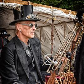 Guardian With Trumpet Gun by Marco Bertamé - People Portraits of Men ( glasses, trumpet, black, gun, man, hat,  )